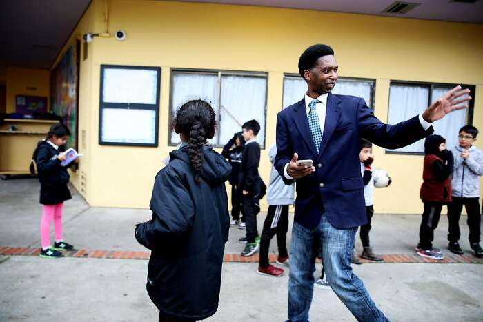San Francisco documentary filmmaker Kevin Epps waves to an individual as he picks up his children, Kamari Epps, 9, left, and Kamia Epps, 6, not pictured, at Dolores Huerta Elementary School in San Francisco, Calif., on Wednesday, January 8, 2020. Epps was held to answer on murder and other charges last month in San Francisco Superior Court after a star witness for the prosecution recounted the details of what happened during a fatal shooting inside a Diamond Heights apartment in 2016. Epps is out on bail after a judge determined he was not a threat to the community and his case is being closely watched by advocates, especially in Bayview Hunters Point where Epps grew up.