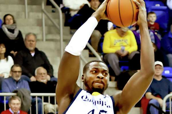 Kevin Marfo of Quinnipiac University hauls down a rebound against Fairfield University last month. Marfo leads the nation in rebounding.