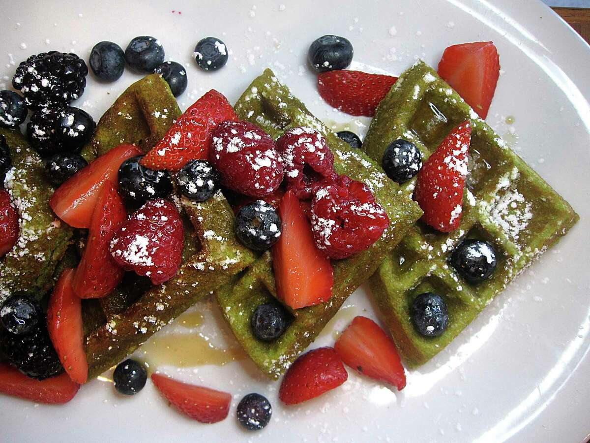 Matcha-kale waffles with berries and maple syrup are part of the vegan menu at Marla Restaurant.
