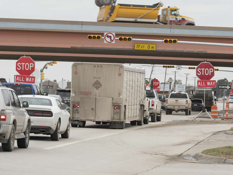 Traffic is backed up 02/20/19 at the intersection of Big Spring St. and Loop 250 with stop signs erected as they replace lights at all four intersections. Tim Fischer/Reporter-Telegram Photo: Tim Fischer/Midland Reporter-Telegram