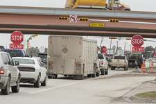 Traffic is backed up 02/20/19 at the intersection of Big Spring St. and Loop 250 with stop signs erected as they replace lights at all four intersections. Tim Fischer/Reporter-Telegram