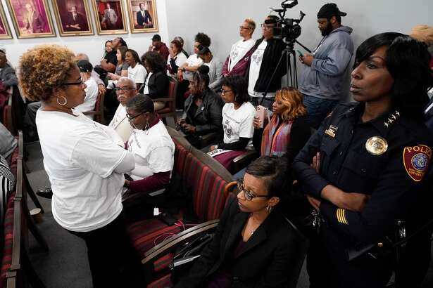 Karla Brown, an alumni, stands with her back to the Texas Southern University board of regents meeting after they motioned to accept the proposal presented in mediation, which finalized the termination of TSU president Austin Lane Thursday, Feb. 19, 2020 in Houston.
