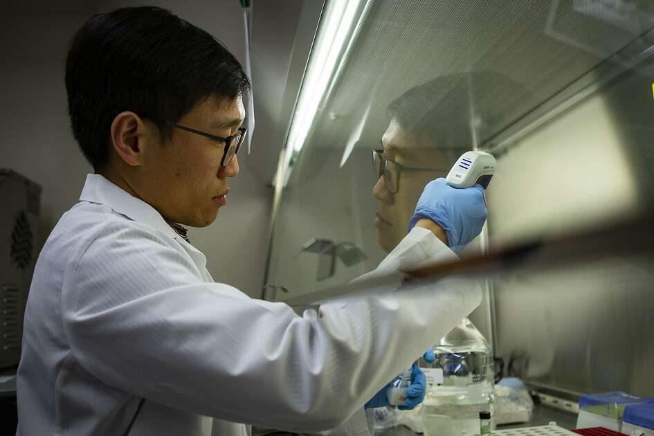 Director of Quality Control Wen Chen, PhD, prepares vials of a vaccine developed to prevent SARS, Tuesday, Feb. 18, 2020, inside the a lab at the Texas Children's Hospital Center for Vaccine Development - Baylor College of Medicine in Houston. Scientists at the medical center are hoping to use the vaccine they previously developed to fight SARS on the recently emerged Coronavirus which shares an 80 percent similarity to SARS one.