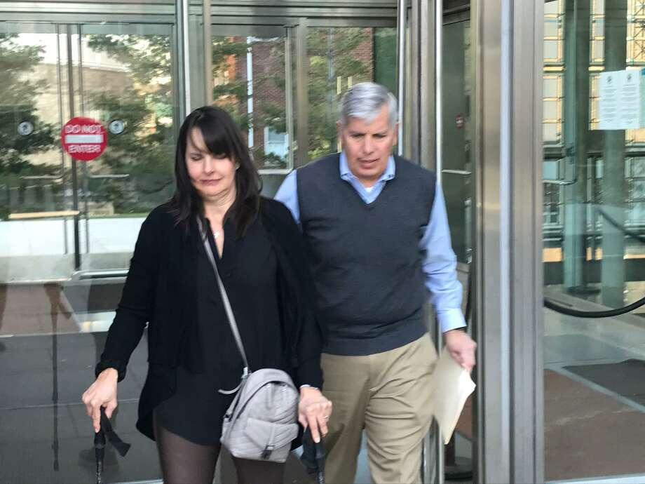 Carrie Maturo and her husband Frank, of Darien, leave the Stamford courthouse after the man who crashed into her car while driving drunk, partially paralyzing her, was sentenced to 10 years in jail. Photo: John Nickerson / Staff Photo