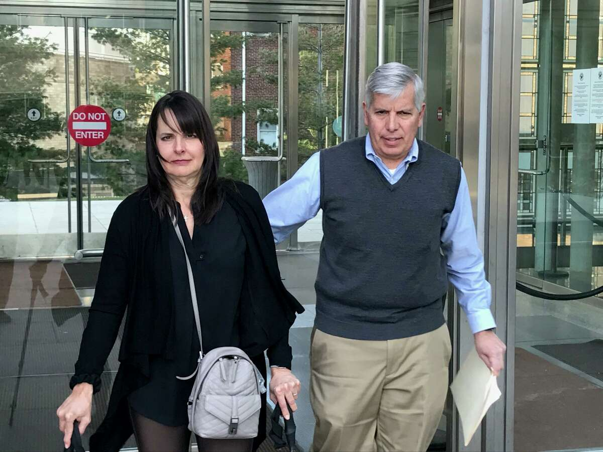 Carrie Maturo and her husband Frank, of Darien, leave the Stamford courthouse after the man who crashed into her car while driving drunk, partially paralyzing her, was sentenced to 10 years in jail.