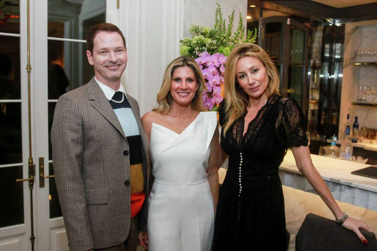 Brian McCulloch, from left, Greggory Burk and Belen Hormaeche at a cocktail party for Best Dressed honorees in Houston on February 19, 2020.