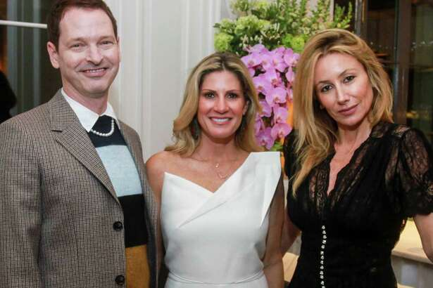 EMBARGOED FOR SOCIETY REPORTER UNTIL FEB. 25 Brian McCulloch, from left, Greggory Burk and Belen Hormaeche at a cocktail party for Best Dressed honorees n Houston on February 19, 2020.
