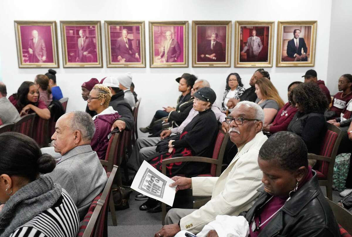 People attend the Texas Southern University's board of regents meeting Thursday, Feb. 20, 2020 in Houston. They are meeting for the first time since giving their notice of termination for sidelined TSU president Austin Lane earlier this month.