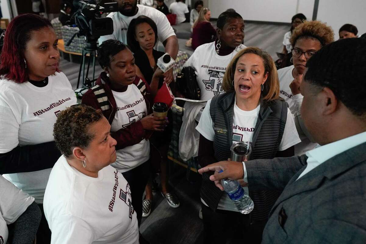 Tracie Payne, second from right, among other alumni, who spoke about their support of fired Texas Southern University president Austin Lane, as they wait as the board of regents meets in executive session Thursday, Feb. 20, 2020 in Houston. The TSU board is meeting for the first time since giving their notice of termination for sidelined TSU president Austin Lane earlier this month.