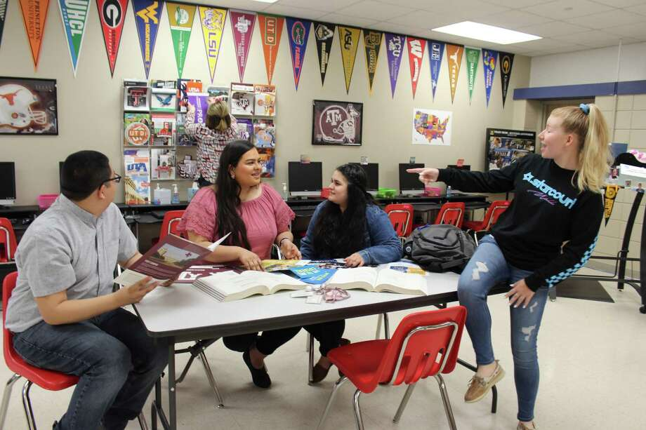 """As they sit in a classroom at Rayburn High School, seniors Adrian Garcia, left, Lorrie Herrera, Ashley Hernandez and Casey Torrence will be attending San Jacinto College in the fall on the Harris County Promise Program. """"I'm so excited I can't put it into words,"""" Torrence said. Photo: Yvette Orozco / Yvette Orozco"""