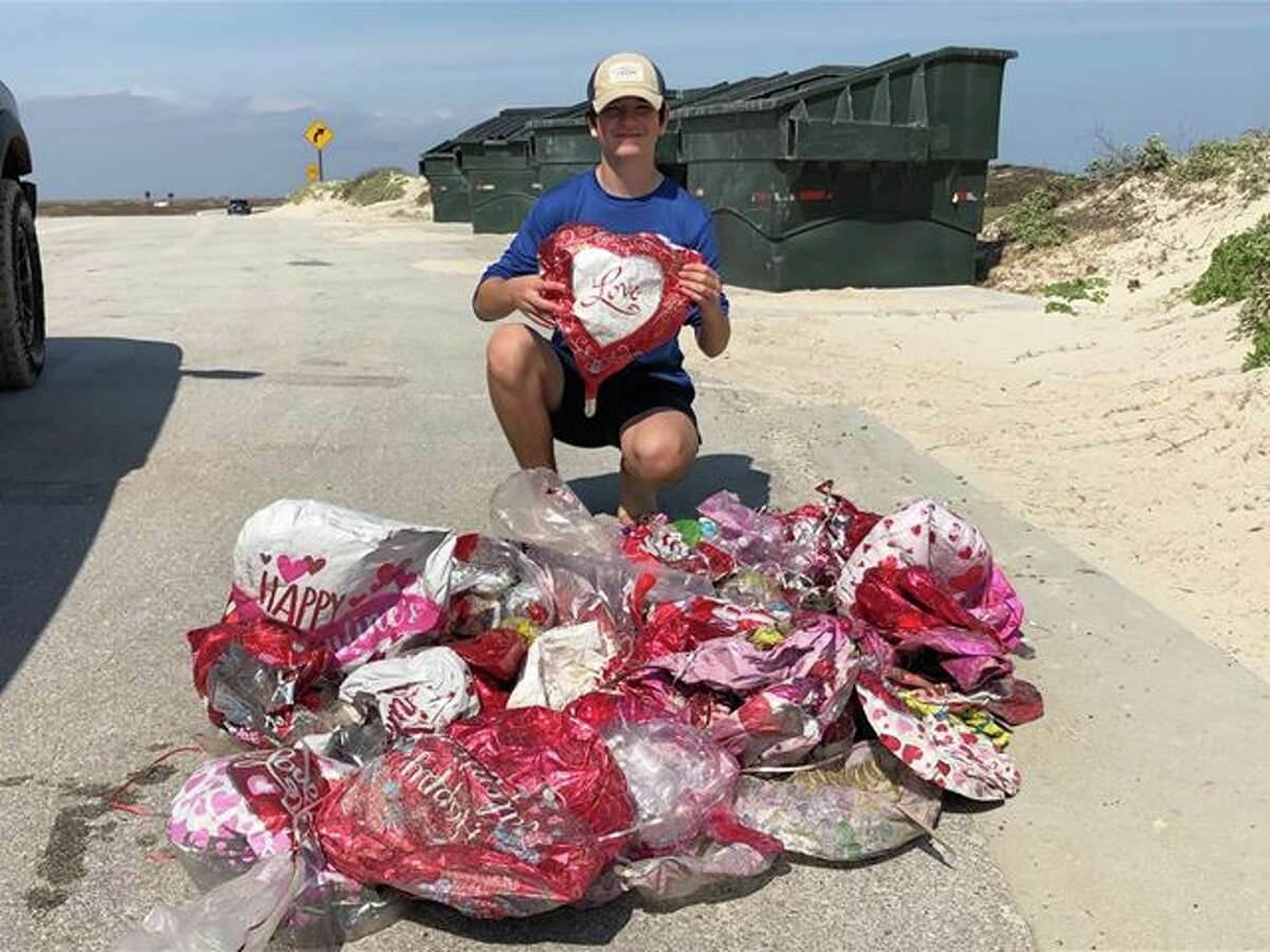 Last year, Viv Ibarra and her son Andrew picked up 67 Valentine's Day balloons at Padre Island National Seashore.