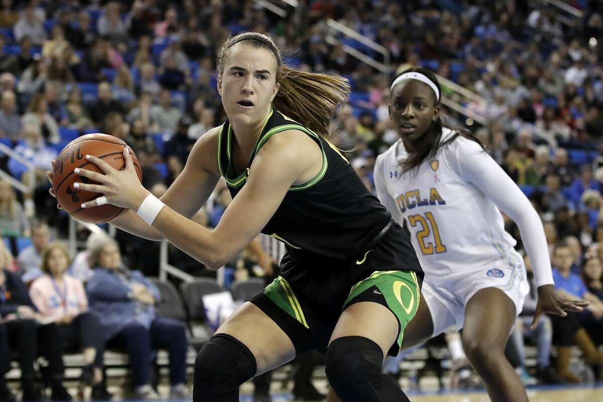 Oregon guard Sabrina Ionescu, left, grabs a rebound in front of Oregon forward Erin Boley (21) during the second half of an NCAA college basketball game Friday, Feb. 14, 2020, in Los Angeles. (AP Photo/Marcio Jose Sanchez)