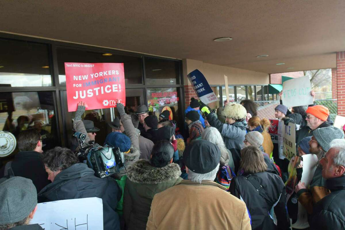 Protestors hold a rally outside the front doors of the Rensselaer County Sheriff's office on on Thursday, Feb. 20, 20202, in Troy, N.Y. Matthew Albence, the acting U.S. Immigration and Customs Enforcement (ICE) director, was holding a press conference inside the building. (Paul Buckowski/Times Union)