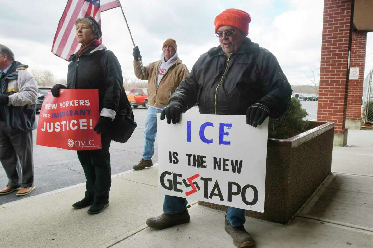 Protestors hold a rally outside the front doors of the Rensselaer County Sheriff's office on on Thursday, Feb. 20, 20202, in Troy, N.Y. (Paul Buckowski/Times Union)