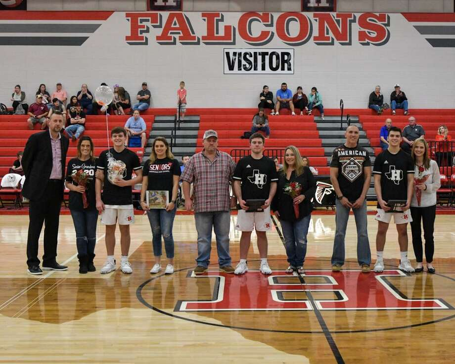 The final Hargrave boys basketball game of the regular season was Senor Night, so the three seniors (left to right: Mason Bennett, Grant Cox, Peyton Pierson) on the team were recognized in a ceremony before the game at the Falcons Nest in Huffman on Feb. 18. Photo: Greg Valk, 59N Sports