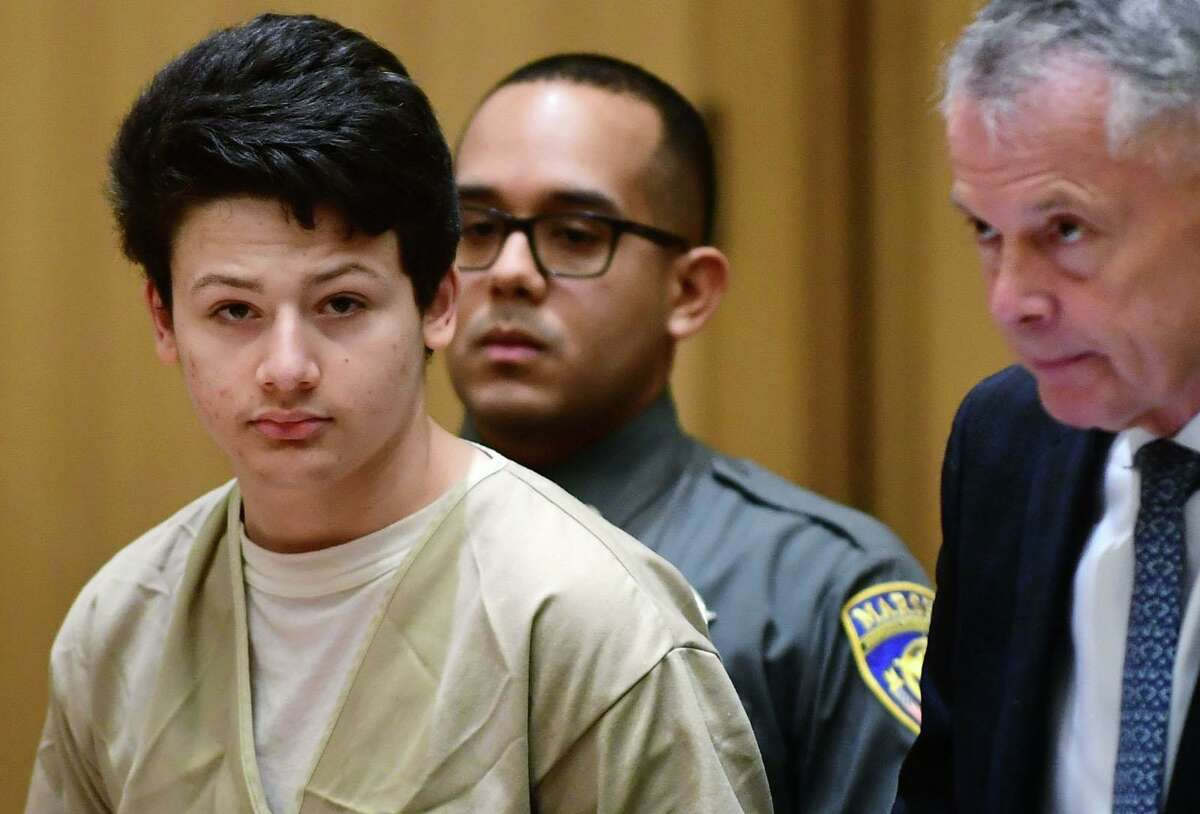 Ellis Tibere, 18, who is accused of attempted murder appears at Stamford Superior Court with his attorney John Gulash on Tuesday, Feb. 18, 2020 in Stamford, Connecticut. Tibere was charged with attempted murder after allegedly repeatedly stabbing a 33-year-old Greenwich woman who was waiting in her car for an appointment in Westport on Jan. 6.