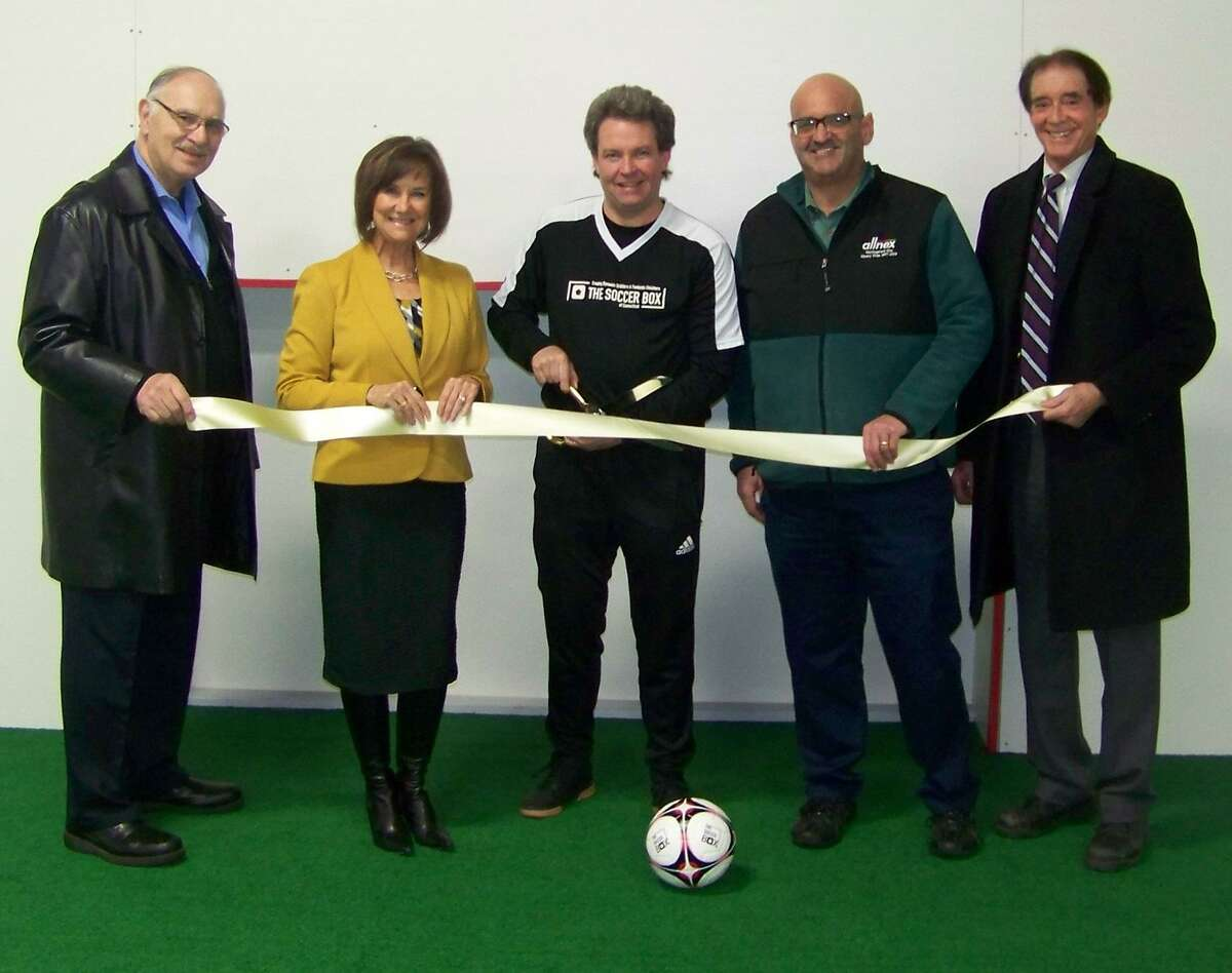 Goal!: From left, Wallingford Economic Development Commission Chairman Joe Mirra; Quinnipiac Chamber of Commerce Executive Director Dee Prior-Nesti; owner/coach Don Dione; Quinnipiac Chamber of Commerce board Chairman Frank DiCristina; and Wallingford Mayor William Dickinson attend the ribbon-cutting and grand opening for The Soccer Box of Connecticut, 950 Yale Ave. in Wallingford recently. The state-of-the-art individual soccer skills training facility accelerates player development in the key skills of dribbling and finishing, according to a release. For information call 860-328-1106 or visit www.TheSoccerBoxCT.com.