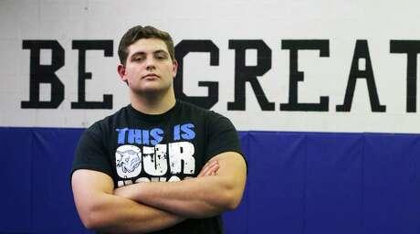 New Braunfels High School senior wrestler George Marsh stands in the wrestling gym at the high school on Feb. 19, 2020.