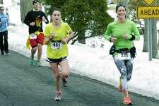 Runners participate in the 30th edition of the Polar Bear Run around Lake Waramaug, Feb. 23, 2014.