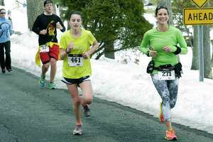 Runners participate in the 30th edition of the Polar Bear Run around Lake Waramaug, Feb. 23, 2014.
