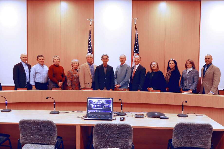 The new Town Council lined up for a picture after they chose their new leadership in Town Hall on Nov. 13, 2019. From left to right, Mark Gryzmski, Tom Butterworth, Liz Donovan, Penny Young, Richard Townsend, John Engel, Sven Englund, Steve Karl,  Christina Aquirre-Ross,  Maria Naughton, Robin Bates-Mason and Mike Mauro. Photo: Grace Duffield / Hearst Connecticut Media