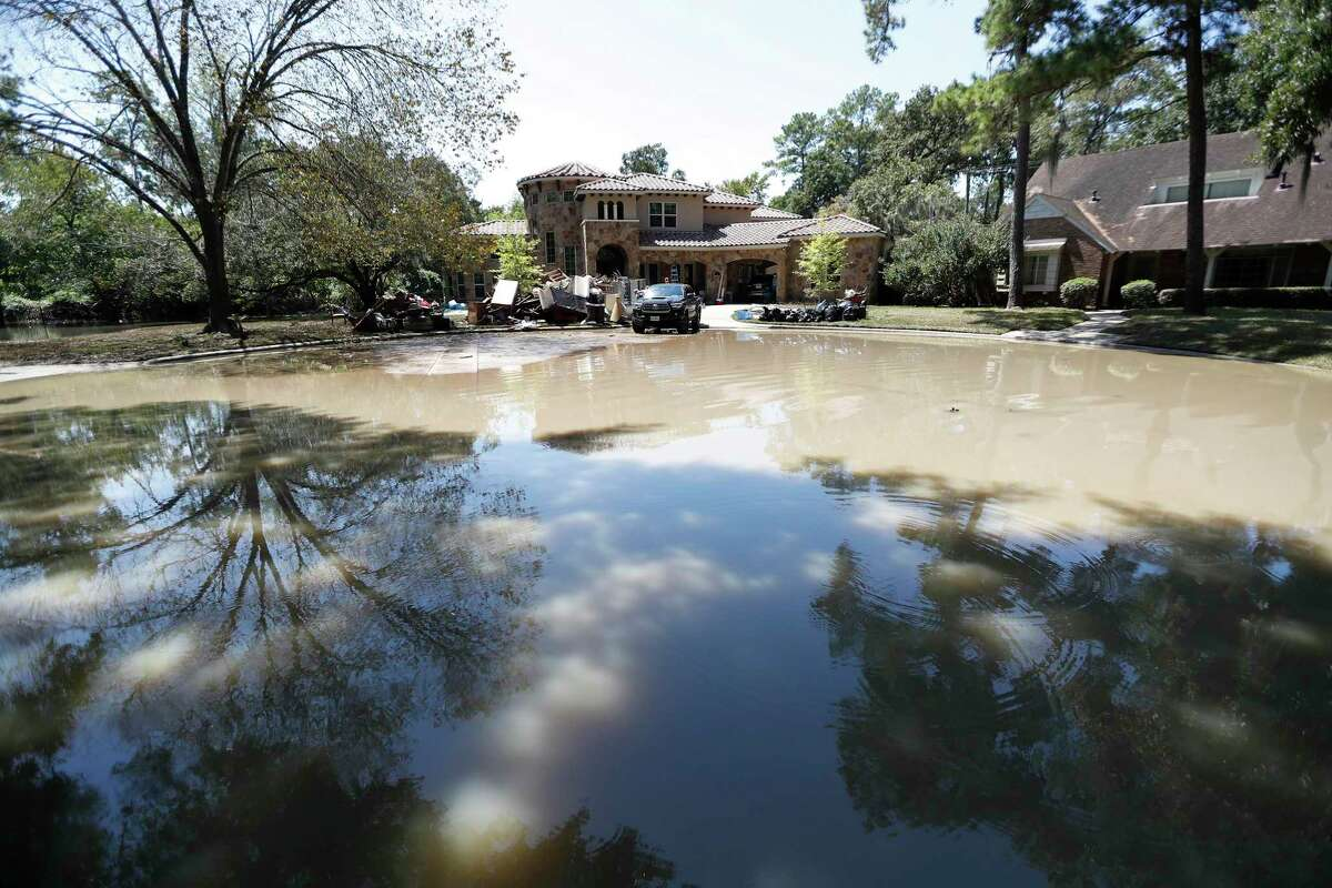 Flood water remains at the end of a cul-de-sac in the Memorial Glen subdivision, west of Beltway 8, near Memorial and Wilchester, Friday, Sept. 8, 2017, in Houston.