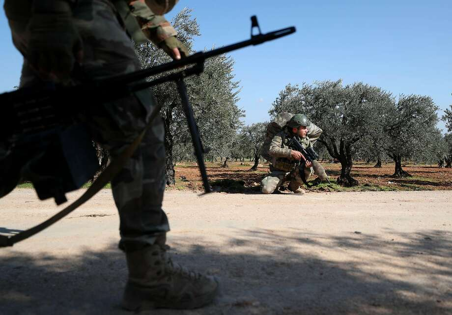 Turkish soldiers take positions near the village of al-Nayrab, about 9 miles southeast of the northwestern city of Idlib. At least 15 Turkish soldiers have been killed in Syria this month. Photo: Omar Haj Kadour / AFP / Getty Images