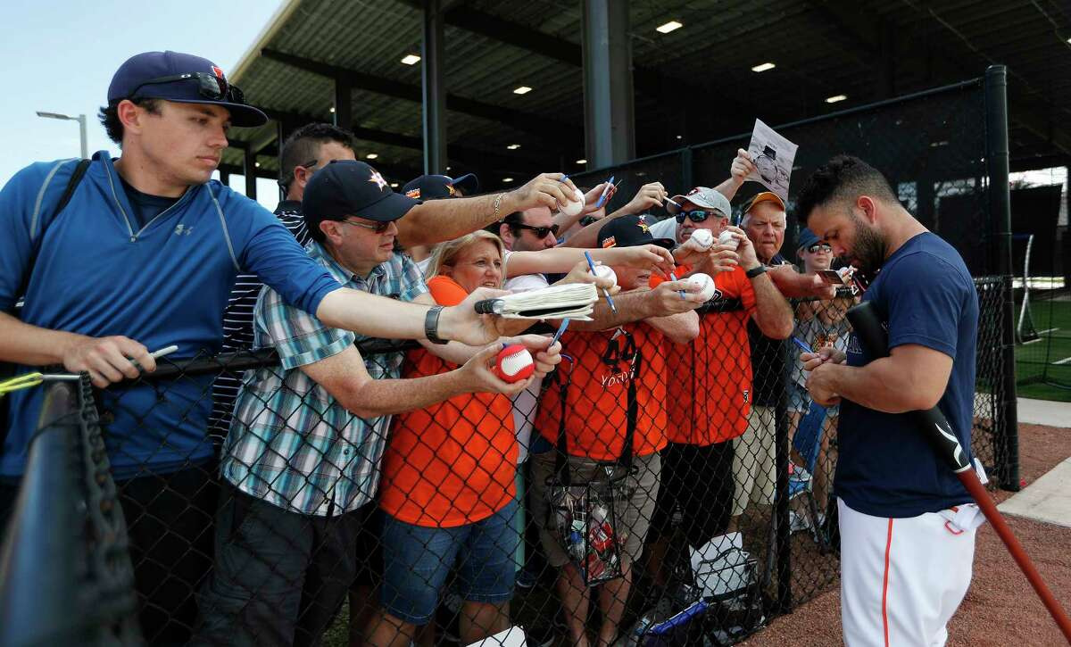Houston Astros second baseman Jose Altuve signs autographs for fans after the Houston Astros spring training workouts at the Fitteam Ballpark of The Palm Beaches, in West Palm Beach , Thursday, Feb. 20, 2020.