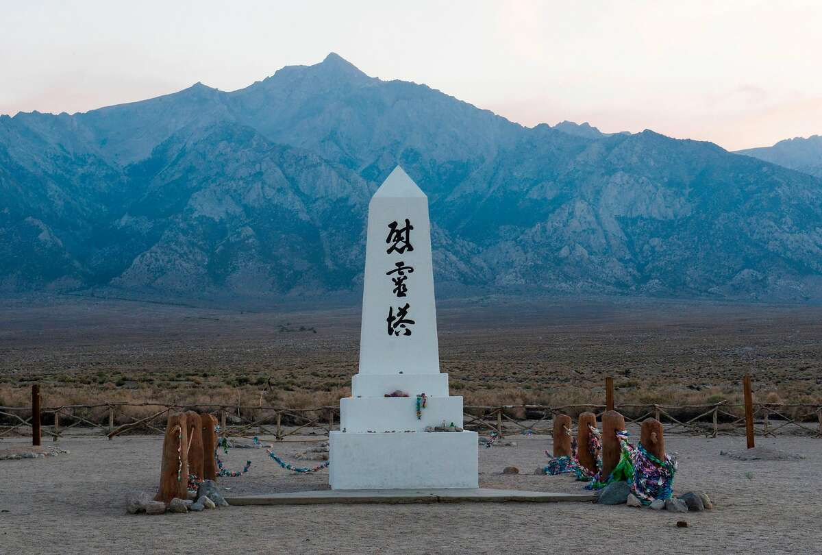 (FILES) In this file photo taken on August 02, 2015 a monument honoring the dead is seen against the background of the Eastern Sierra mountains, August 2, 2015, at the WW II - era Manzanar internment camp, in Manzanar, California, approximately 230 miles (370 km) northeast of Los Angeles, August 2, 2015. - Nearly 80 years after the US authorized the internment of Japanese-Americans during World War II, California plans on February 20, 2020, to formally apologize this week for its role in one of the darkest chapters in US history. (Photo by ROBYN BECK / AFP) (Photo by ROBYN BECK/AFP via Getty Images)