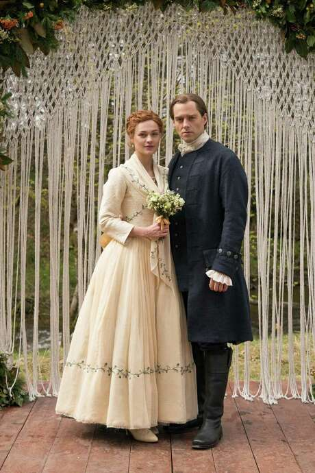 "Sophie Skelton and Richard Rankin in the Starz series, ""Outlander."" (Aimee Spinks/Starz Entertainment/TNS)"