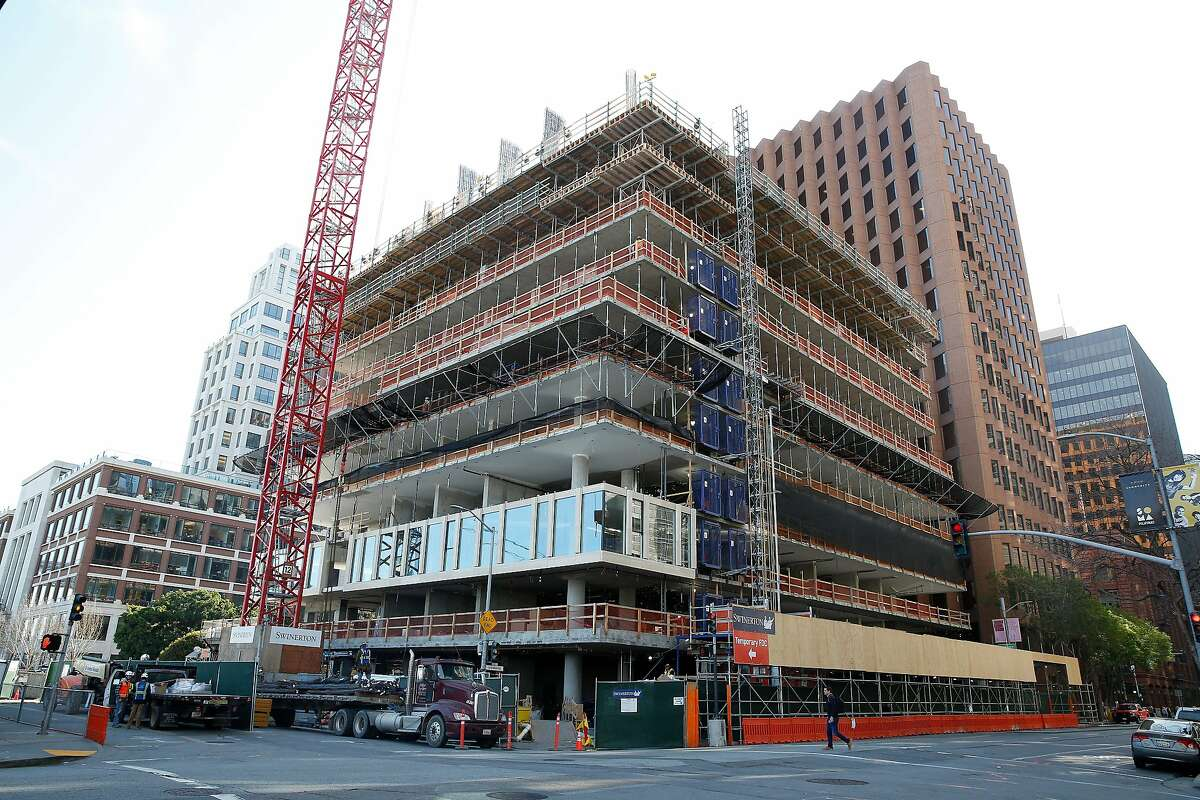 Construction is under way at the One Steuart Lane at 75 Howard Street condo project, part of the wave of deluxe offerings being built in S.F.