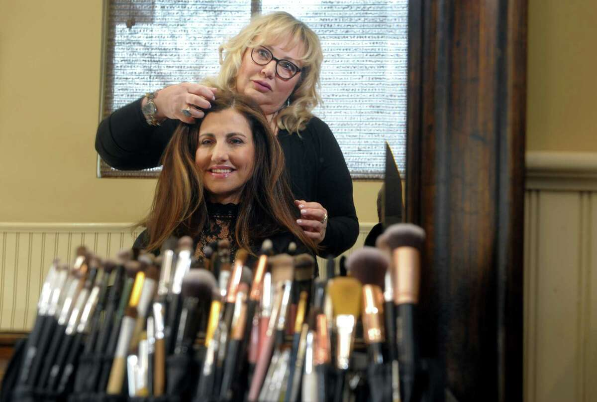 Janet Ventriglia works as a makeup and hair stylist at H Salon, in Fairfield, Conn. Ventriglia is seen here with one of the salon's co-owner Jackie Fernandes on Feb. 20th, 2020.