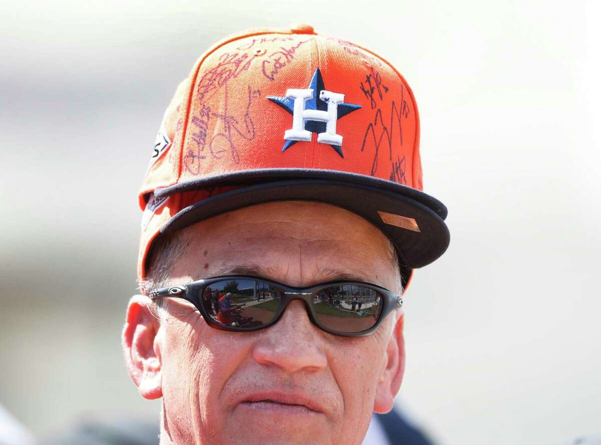 Benny Bell wears two Astros baseball caps as he waited for autographs during the Houston Astros spring training workouts at the Fitteam Ballpark of The Palm Beaches, in West Palm Beach , Thursday, Feb. 20, 2020.
