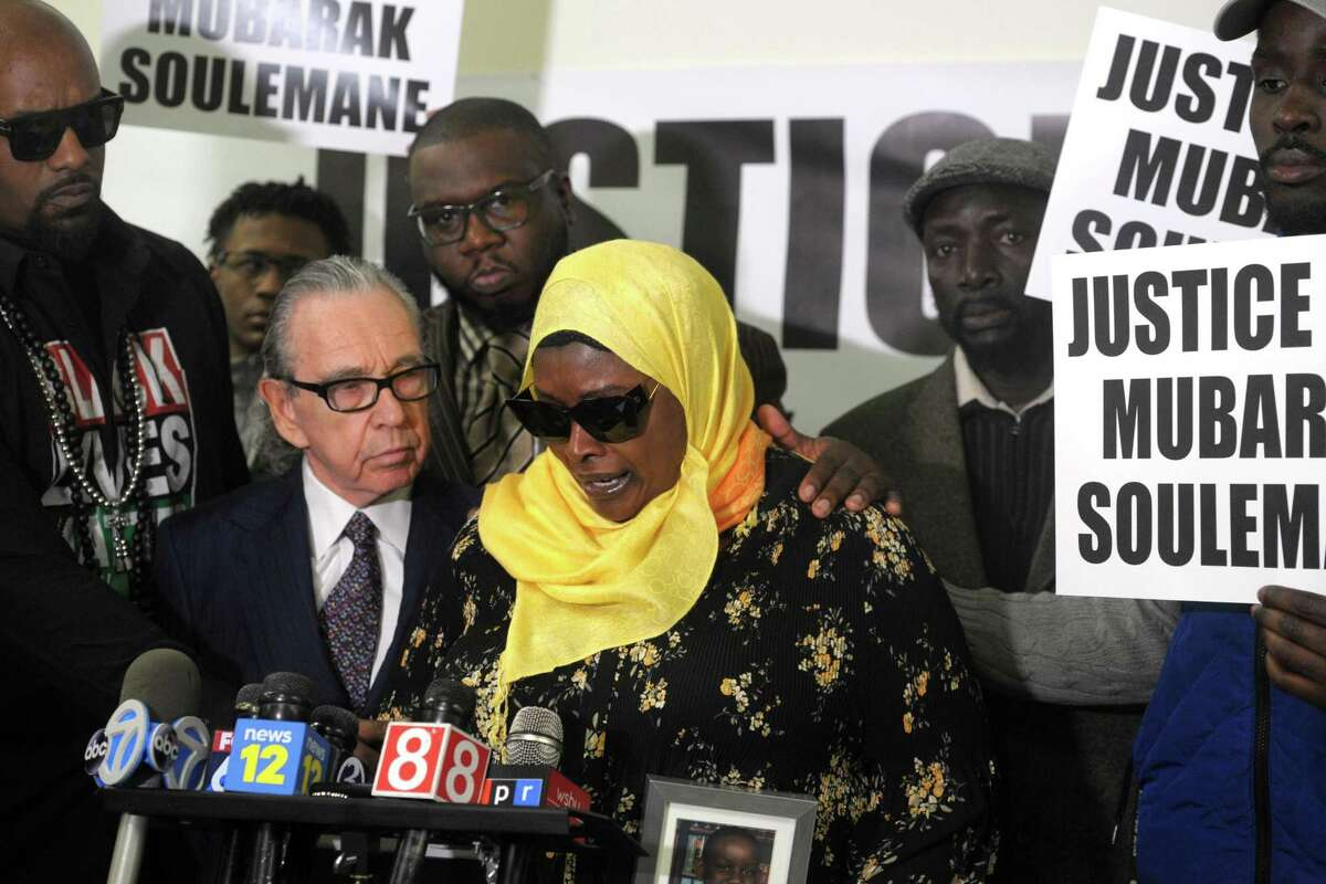 Omo Mohammed, mother of slain teen Mubarak Soulemane, speaks at a news conference in Bridgeport, Conn. Feb. 20, 2020. Soulemane, 19, was shot and killed by a state police trooper Jan. 13 in West Haven after he allegedly stole a car from an individual in Norwalk and fled from police at high at speeds that reached 90 mph along Interstate 95. His family announced Thursday they intend to file a $10 million lawsuit against the state, the state police, the city of West Haven and the West Haven Police Department.