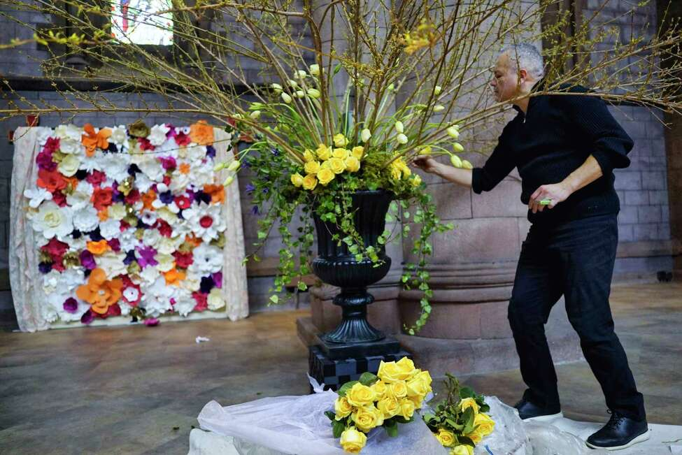 Deryck Dematas, owner of Designs by Deryck out of Albany works on his floral display for the Cathedral in Bloom 2020 flower show at the Cathedral of All Saints Episcopal church on Thursday, Feb. 20, 2020, in Albany, N.Y. This is the second year of the show and over 30 florists will display their work at the show. The show opens on Friday at 10am, and the champagne gala reception is on Friday from 7pm to 10pm. The flower show is open Saturday from 10am to 6pm and Sunday from 12 noon to 4pm. The three days of the show will included workshops, presentations by the region?•s leading florists, a public flower market, tours of the gothic cathedral, an organ recital, and afternoon tea among the flowers. A portion of the money raised from the event will be donated to the Community Loan Fund. (Paul Buckowski/Times Union)