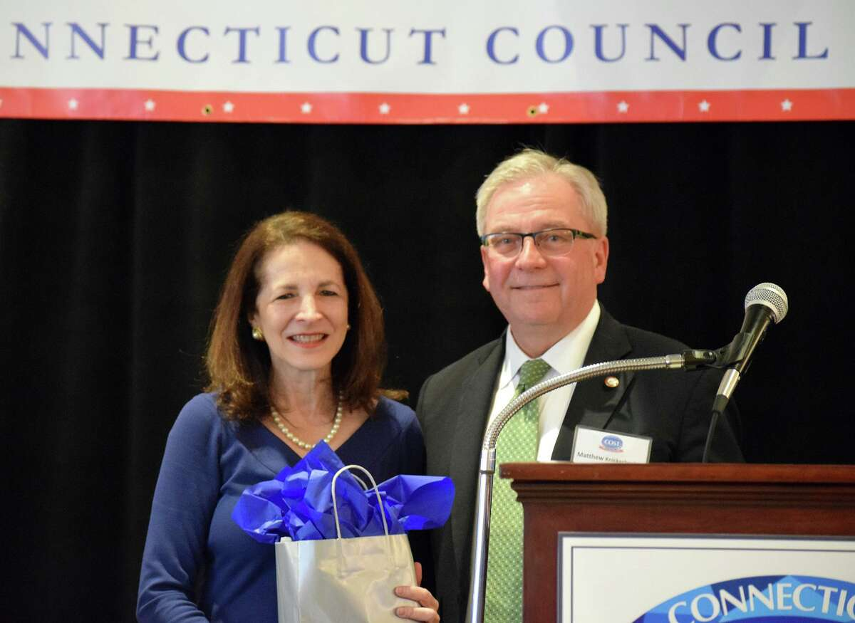 Bethel First Selectman Matt Knickerbocker presents state Rep. Gail Lavielle with the Connecticut Council of Small Towns' Town Crier Award on Feb. 18, for her work last year in helping to fend off efforts to regionalize school districts around the state as well as other work she did in advocating for public policies that benefit Connecticut's small towns.