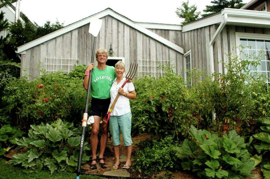 Rob and Sharon Slocum at their Weed Circle home in Stamford, Conn. on Monday August 16, 2010.  Rob is a rower who's competed around the world and Sharon is a landscape designer who has planted their backyard with both vegetable and decorative plants. Photo: Dru Nadler / Stamford Advocate