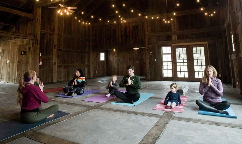 Nature Yoga sessions in the barn at the Greenwich Audubon Center. Photo: File / Scott Mullin / For Hearst Connecticut Media / The News-Times Freelance