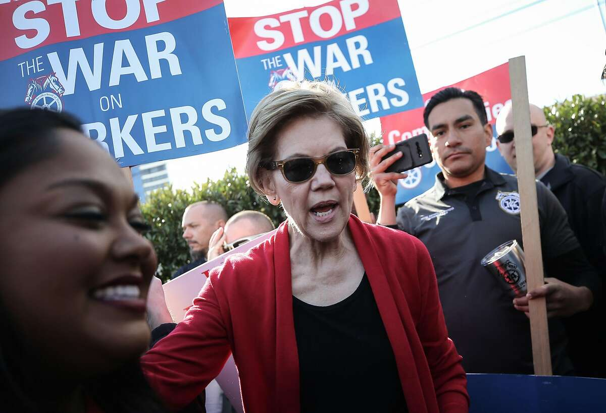 LAS VEGAS, NEVADA - FEBRUARY 19: Democratic presidential candidate Sen. Elizabeth Warren (D-MA) (C) walks with members of Culinary Workers Union Local 226 on a picket line outside of Palms Casino Resort on February 19, 2020 in Las Vegas, Nevada. The upcoming Nevada Democratic presidential caucus will be held February 22 and a Democratic presidential debate will be held later today in Las Vegas. (Photo by Mario Tama/Getty Images)