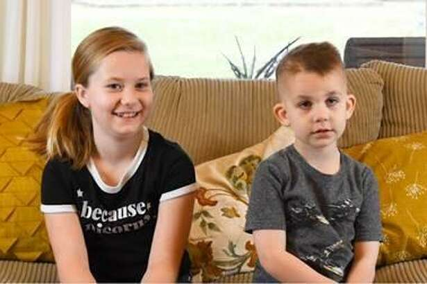 Owen Langston, right, has beaten cancer twice. Here is it with his sister Claire.