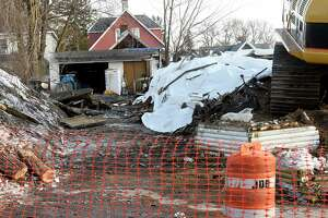 A house at 126 Robinson St. was demolished due to a fire that destroyed the whole structure on Thursday, Feb. 20, 2020 in Schenectady, N.Y. Four people and three dogs got out. There were no injuries. (Lori Van Buren/Times Union)