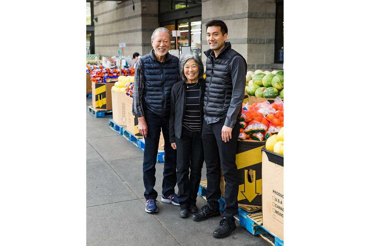 Glenn Yasuda (left) with his wife, Diane, and son, Gen, outside Berkeley Bowl on Oregon Street.