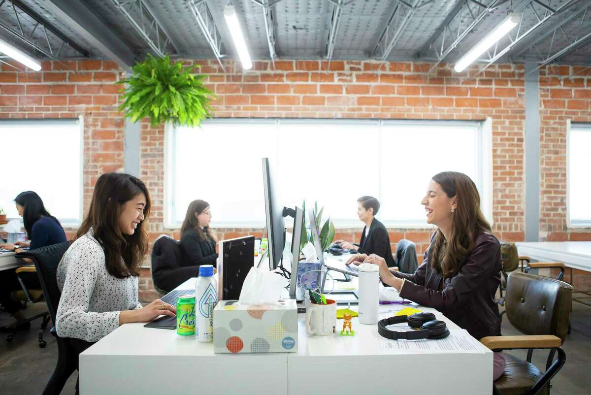 Carolyn Rodz (right), founder and CEO of Alice, a company that seeks to help small businesses grow by matching them with business opportunities, works with her team, Thursday, Feb. 13, 2020, inside their Houston office.