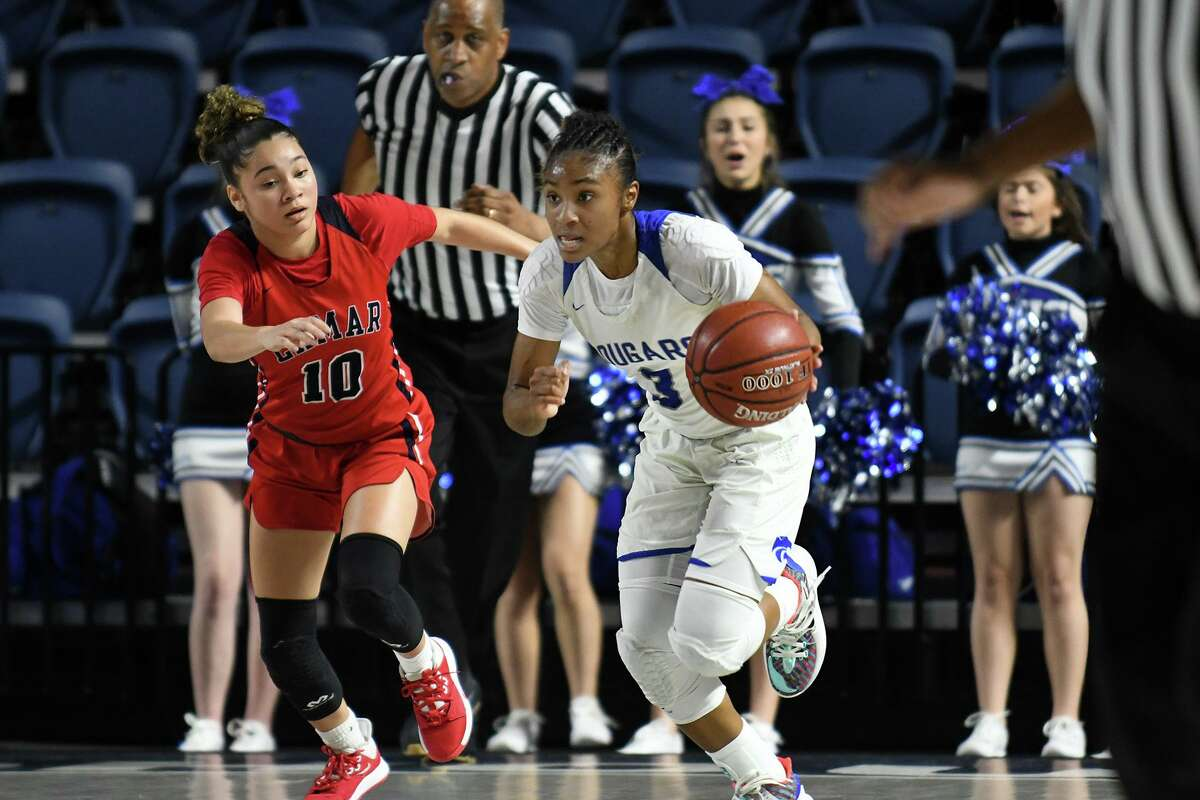 Cy Creek's Rori Harmon, leading a fast break in last season's playoffs, has signed with Texas.