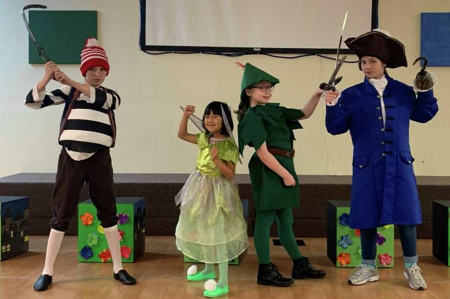 """Emmerie Ricketts, Helen Zhou, Delaney Cline, Olivia Varanauski will perform in Kids' Backporch Productions' """"Tinker Bell."""" The show will be Feb. 28 through March 1 at Shadycrest Baptist Church in Pearland. Photo: Courtesy Kids' Backporch Productions"""