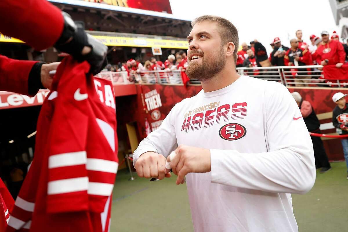 San Francisco 49ers' Ben Garland readies to sign an autograph before playing Green Bay Packers during NFC Championship Game at Levi's Stadium in Santa Clara, Calif., on Sunday, January 19, 2020.