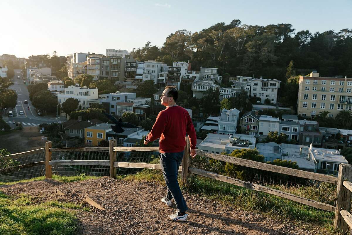 Yihao Xie, an environmental researcher in San Francisco, who says he stayed away from the office after a trip to China, walks in Corona Heights Park on Feb. 12, 2020. Though there are only a few known cases in the U.S., the coronavirus outbreak has left some Asian-Americans feeling an unsettling level of public scrutiny. (Jason Henry/The New York Times)