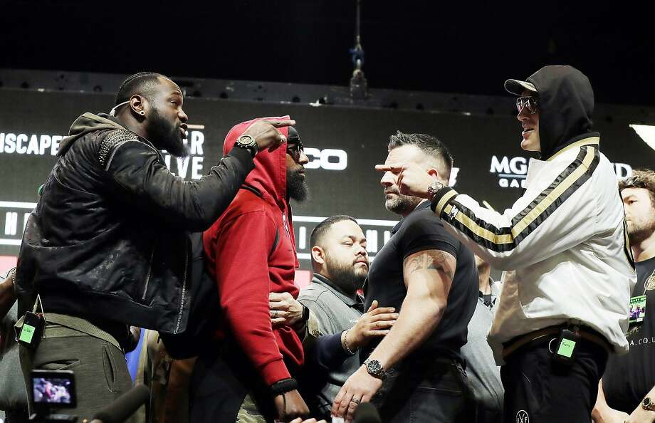 The Deontay Wilder (left) and Tyson Fury (right) rematch Saturday is said to be the biggest heavyweight fight in 18 years. Photo: Isaac Brekken / Associated Press