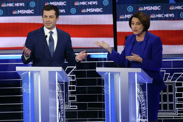 Democratic presidential candidates former South Bend, Ind., Mayor Pete Buttigieg, left, and Sen. Amy Klobuchar (D-Minn.) participate in the Democratic presidential primary debate at Paris Las Vegas on Wednesday, Feb. 19, 2020, in Las Vegas. (Mario Tama/Getty Images/TNS)