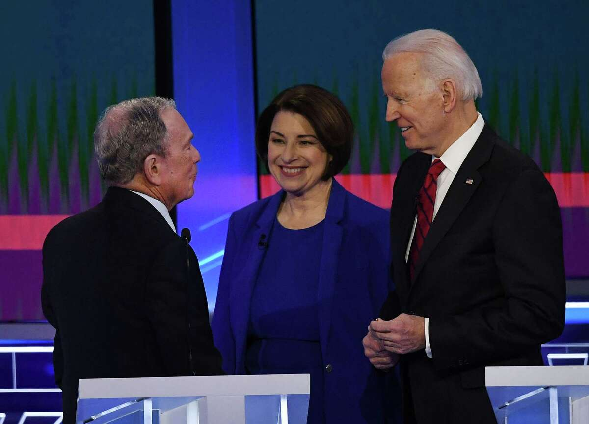 Democratic presidential hopefuls Former New York Mayor Mike Bloomberg (L), Indiana Senator Amy Klobuchar and Former Vice President Joe Biden (R) talk during abreak during the Democratic Presidential Debate hosted by NBC News and MSNBC with The Nevada Independent at the Paris Las Vegas Hotel in Las Vegas, Nevada, on February 19, 2020. (Photo by Mark RALSTON / AFP) (Photo by MARK RALSTON/AFP via Getty Images)